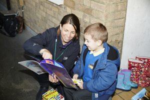 Volunteer reading with children