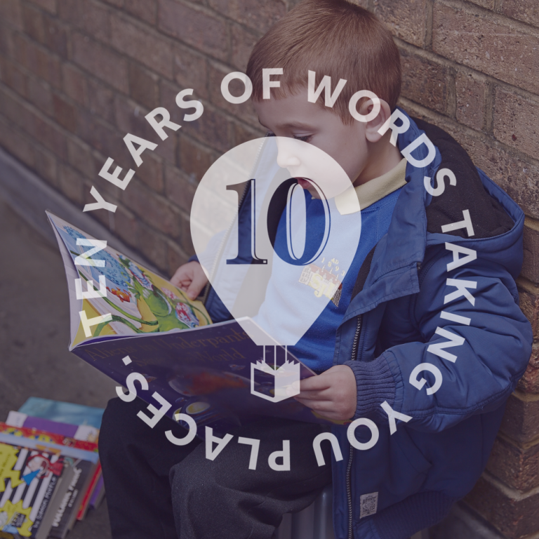 Little boy reading with 10 Years Of Words Taking You Places written over top